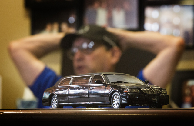Alan Waxler, CEO of AWG Ambassador, sits in his office at  4676 Wynn Road on Friday, April 25, 2014. His office window and limos have been shot with pellet guns. There have been reports of escalat ...