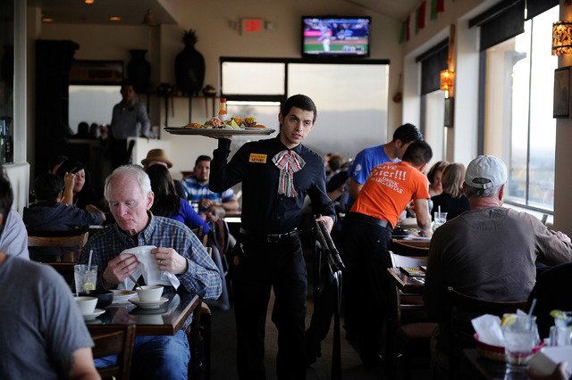 A server delivers entrees to restaurant patrons at Lindo Michoacan La Loma in Henderson on Sunday, March 30, 2014. (David Becker/Las Vegas Review-Journal)