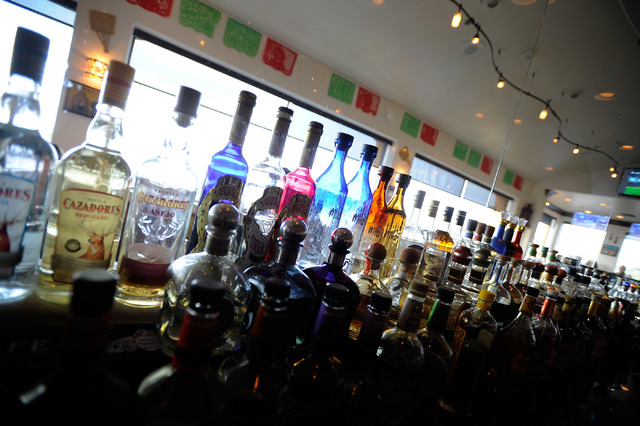 Bottles of tequila line the back bar at Lindo Michoacan La Loma in Henderson on Sunday, March 30, 2014. (David Becker/Las Vegas Review-Journal)