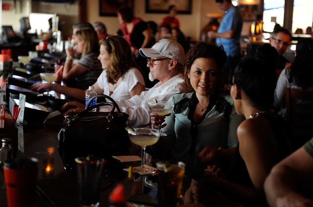 Customers sit along the bar, some drinking margaritas, at Lindo Michoacan La Loma in Henderson on Sunday, March 30, 2014. (David Becker/Las Vegas Review-Journal)