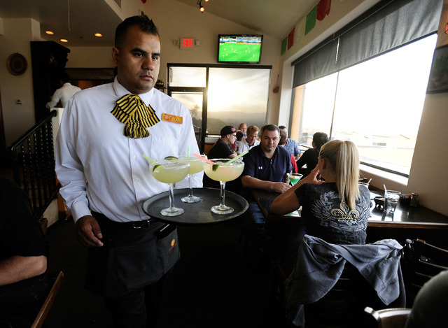 Server Cesar Hernandez delivers margaritas to restaurant patrons at Lindo Michoacan La Loma in Henderson on Sunday, March 30, 2014. (David Becker/Las Vegas Review-Journal)