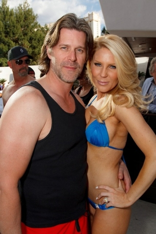 Gretchen Rossi and Slade Smiley looking good at Aria's Liquid pool. (Light Group)