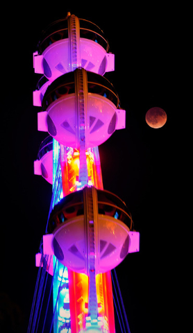 A total lunar eclipse appears next the Las Vegas High Roller at The LINQ early Tuesday, April 15, 2014. People in most of north and south America were able to witness this year's first total lunar ...