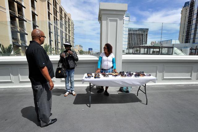 A vendor sells her wears along a pedestrian bridge near  Bally's hotel-casino on Sunday, April 27, 2014. (David Becker/Las Vegas Review-Journal)