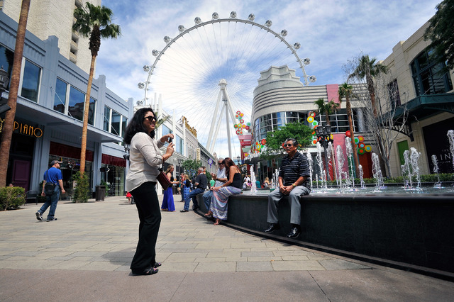 California tourist Mary Lou, left, who declined to give her last name, photographs her father at The LINQ on Sunday, April 27, 2014. (David Becker/Las Vegas Review-Journal)