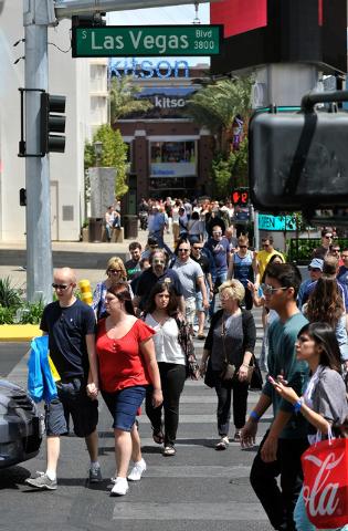 Tourists cross the Strip on Sunday, April 27, 2014. (David Becker/Las Vegas Review-Journal)