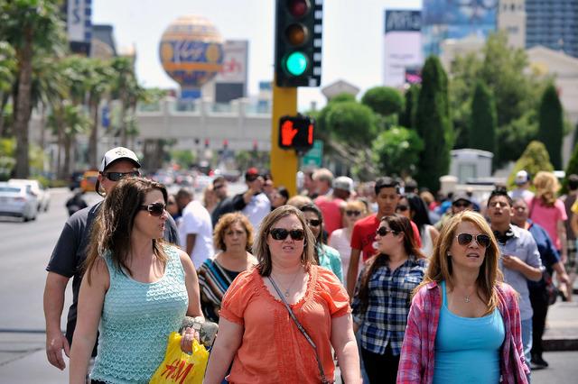 Tourists walk along the Strip near Caesars Palace hotel-casino on Sunday, April 27, 2014. (David Becker/Las Vegas Review-Journal)