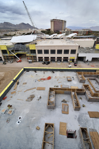 Part of the construction site for the Shops at Summerlin is shown on the northeast corner of Sahara Avenue and the 215 Beltway in Las Vegas on Friday, April 4, 2014. The Red Rock hotel-casino is i ...