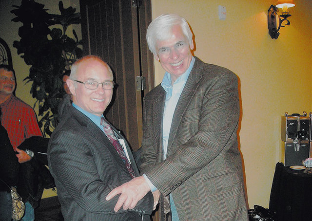 Outgoing Nye County Sheriff Tony DeMeo, right, shakes hands with his assistant sheriff, Rick Marshall, on Feb. 1 at Marshall's kickoff party for his campaign for Nye County sheriff. Marshall was ...