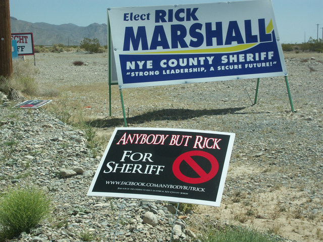 Signs are shown in Nye County for Assistant Sheriff Rick Marshall's campaign for sheriff and for a group that opposes Marshall's candidacy. (Courtesy/Horace Langford Jr./Pahrump Valley Times)