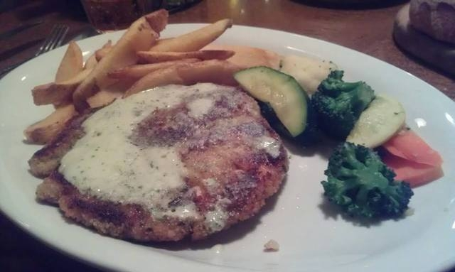 The macadamia chicken at Montana Meat Co. is served with a lemon butter sauce. (Lisa Valentine/View)