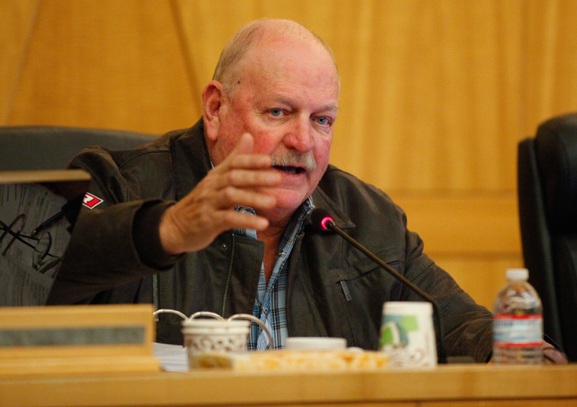 Clark County Commissioner Tom Collins apologized to his fellow commissioners Tuesday over some of his comments made during the Cliven Bundy standoff. Collins is shown here as he speaks during a he ...