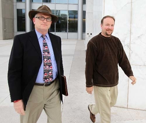 Mortgage broker Steve Grimm, right, leaves the Lloyd George Federal Courthouse in 2011 with federal public defender William Carrico. Grimm was ordered released from federal prison Wednesday while  ...