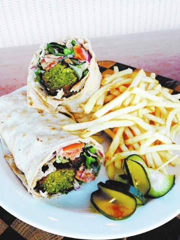 Vegan falafel at MTO Cafe: Garlic tahini, housemade falafel, balsamic chipotle, cucumber, roasted tomato, red onion and romaine are wrapped in whole wheat lavash. (Courtesy)