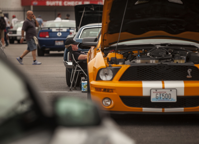 Parked Ford Mustangs during a car show  at the Las Vegas Motor Speedway on Friday, April 18, 2014. Car enthusiasts from around the world attended the 50th anniversary of the Ford Mustang is being  ...
