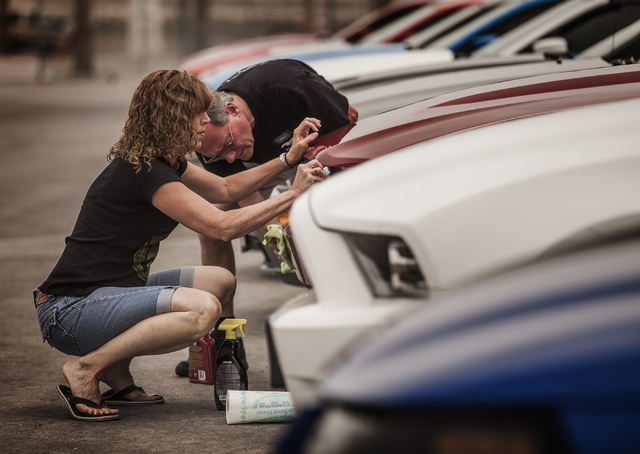 Carol Conger, left, and her husband Ted Carlson polish their  Ford Mustang during the car show  at the Las Vegas Motor Speedway on Friday, April 18, 2014. Car enthusiasts from around the world att ...