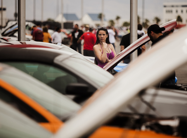 A woman as seen Friday, April 18, 2014 during the Ford Mustang car show at the Las Vegas Motor Speedway. Car enthusiasts from around the world attended the 50th anniversary of the Ford Mustang is  ...