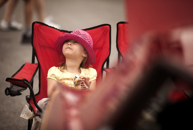 Chanelle Martin, 6, from Vancouver, B.C. sits beside her grandparents 1969 Ford Mustang  Super Cobra Coupe during a car show  at the Las Vegas Motor Speedway on Friday, April 18, 2014. Car enthusi ...