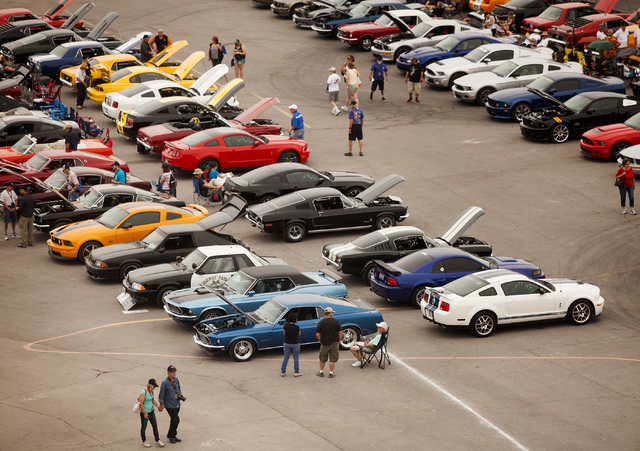 A view of the Ford Mustang car show as seen from the Dale Earnhardt Terrace at the Las Vegas Motor Speedway on Friday, April 18, 2014. Car enthusiasts from around the world attended the 50th anniv ...