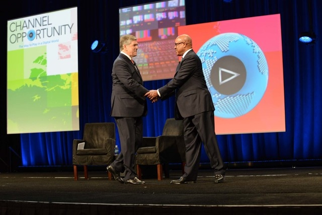 Charles Warfield, president and COO, ICBC Broadcast Holdings, left, greets NAB President and CEO Gordon Smith at the NAB show opening on Monday in Las Vegas. (Courtesy National Association of Broa ...