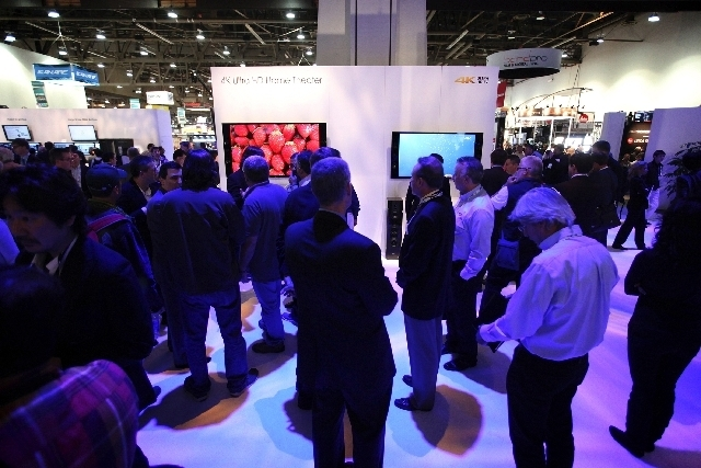 National Association of Broadcasters convention attendees check out the Sony booth at the 2013 edition of the conference. This year's convention begins Saturday. (Jessica Elelhar/Las Vegas Review- ...