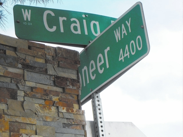 A road sign at the intersection of Craig Road and Pioneer Way is seen in northwest Las Vegas. Craig Road is named for Lois Craig, who was one of the first women to work in the valley's title compa ...