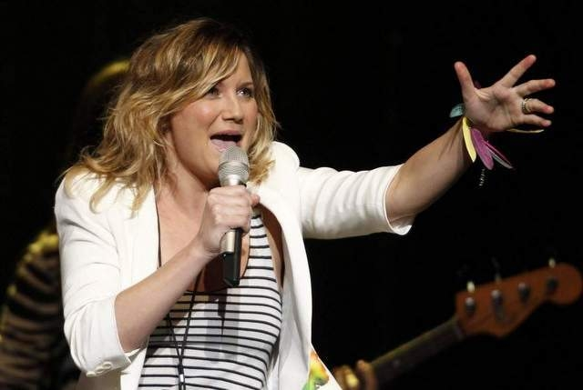 "On her new solo record, ""That Girl,"" singer Jennifer Nettles of Sugarland turns down the volume and cranks up the longing on the spare-sounding, unadorned album. (File/Associated Press)"
