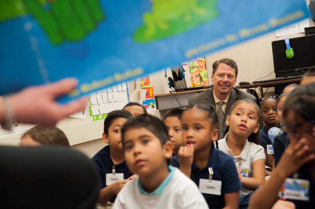 Clark County Superintendent Pat Skorkowsky, top, sits in with kindergarteners during story time at Gene Ward Elementary School on April 10, 2014. Almost every one of Clark County's 217 public el ...