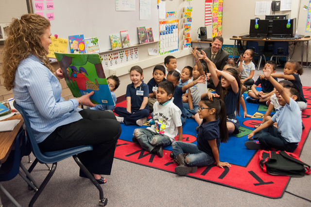 Kindergarten teacher Alex Skeary, left, reads a story to her class, as Clark County Superintendent Pat Skorkowsky, top right, participates at Gene Ward Elementary School in Las Vegas Thursday, Apr ...