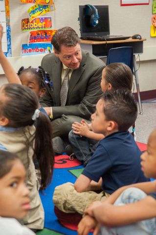 Clark County Superintendent Pat Skorkowsky, top, speaks to Kasandra Pace-Cruz, 5, while sitting in with other kindergarteners during story time at Gene Ward Elementary School in Las Vegas Thursday ...