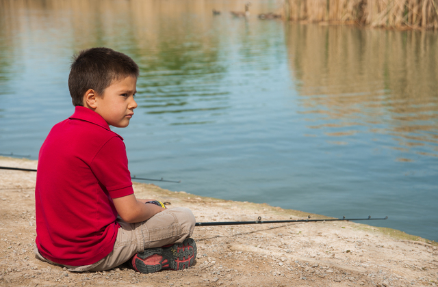 First grade student Garron Brice, 6, from Pinecrest Academy in Henderson, Nev., learn how to fish at Floyd Lamb Park at Tule Springs in Las Vegas Thursday, March 27, 2014. (Martin S. Fuentes/Las V ...