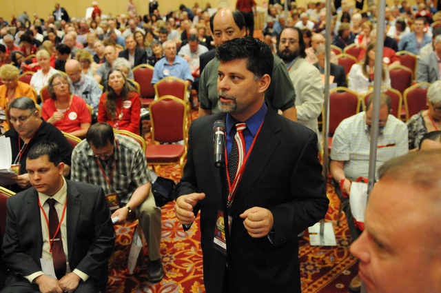 Bill Carns, committee chair at the Nevada Republican Party, speaks gives his opinion on an amendment during the annual Nevada Republican Party convention at the South Point casino-hotel in Las Veg ...