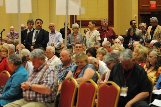 Delegates stand to speak on a motion during the annual Nevada Republican Party convention at the South Point casino-hotel in Las Vegas Saturday, April 12, 2014. (Erik Verduzco/Las Vegas Review-Jou ...