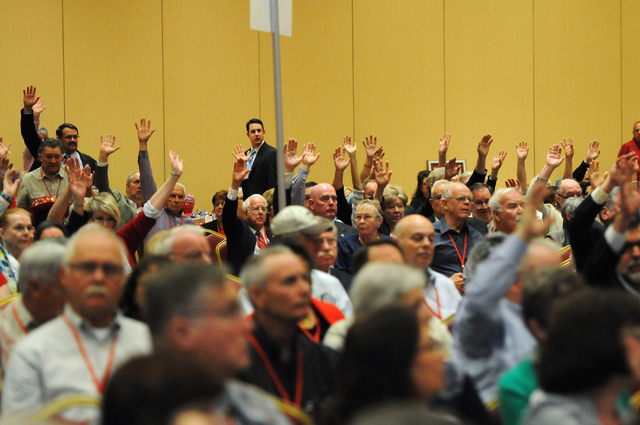 Nevada Republican Party delegates raise their hands during a vote at the annual party convention at the South Point casino-hotel in Las Vegas Saturday, April 12, 2014. (Erik Verduzco/Las Vegas Rev ...