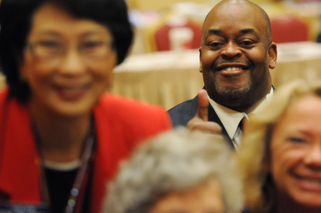 Niger Innis, rear right, Republican candidate for the 4th Congressional District, smiles for the camera during the annual Nevada Republican Party convention at the South Point casino-hotel in Las  ...