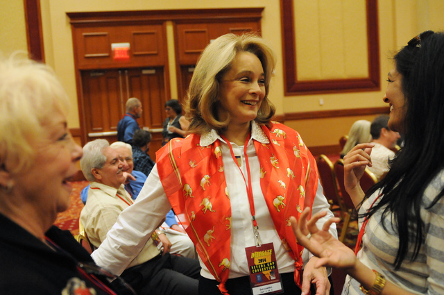 Sue Lowden, center, candidate for Nevada lieutenant governor, speaks to delegate Swati Singh, right, and Barbara Altman, former board member of the Clark County Republican Party, during the Nevada ...