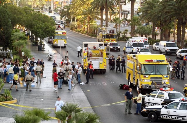 Officials investigate a crime scene on The Strip in Las Vegas on Wednesday Sept. 21, 2005. A driver mowed down a group of pedestrians in front of Bally's casino. (Isaac Brekken/Las Vegas Review-Jo ...