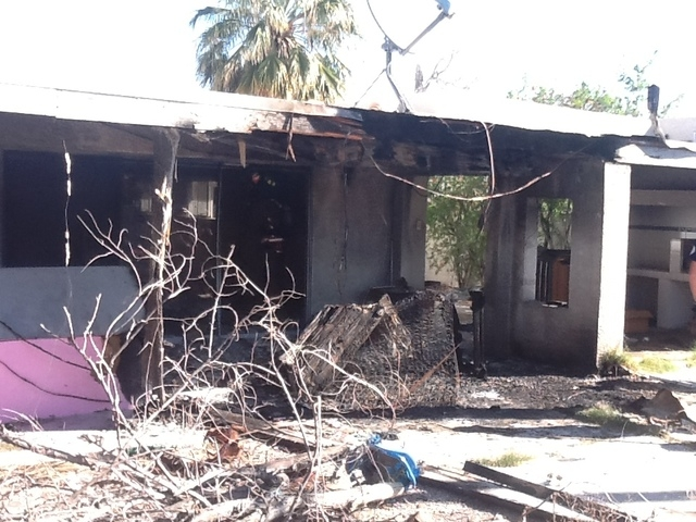 A fire in a sofa on the patio of a vacant house at 556 E. Oakey Blvd. cause $10,000 in damages Thursday morning. (Courtesy/Las Vegas Fire Dept.)