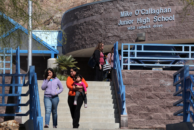 People walk down the steps in from of Mike O'Callaghan Middle School on Thursday. A fight on Wednesday between two students led to one being hospitalized. (Justin Yurkanin/Las Vegas Review-Journal)