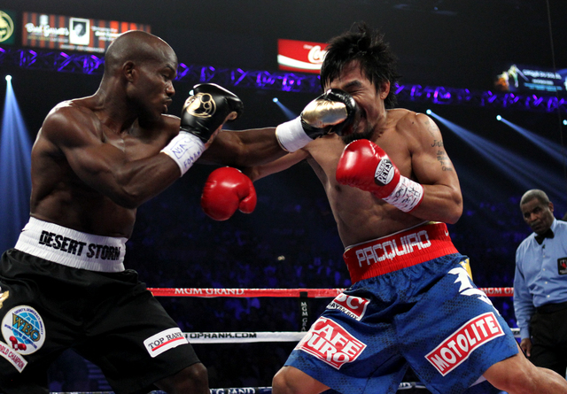 Timothy Bradley hits Manny Pacquiao during their WBO World Welterweight Championship bout at the MGM Grand Garden on June 9, 2012. The two will face each other on April 12 at the MGM Grand Garden. ...