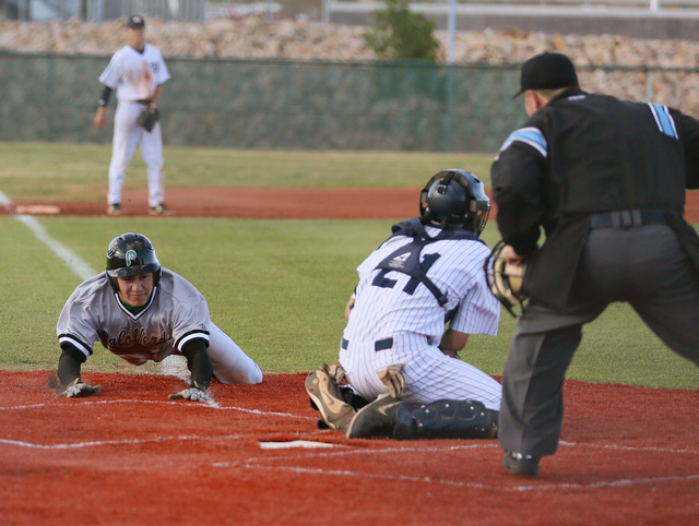 Palo Verde's Mitchell Rathbun, left, slides into home plate near Spring Valley catcher Jake Sellinger in the seventh inning on Tuesday. Rathbun was safe to give the Panthers a 6-5 road win. (Ronda ...