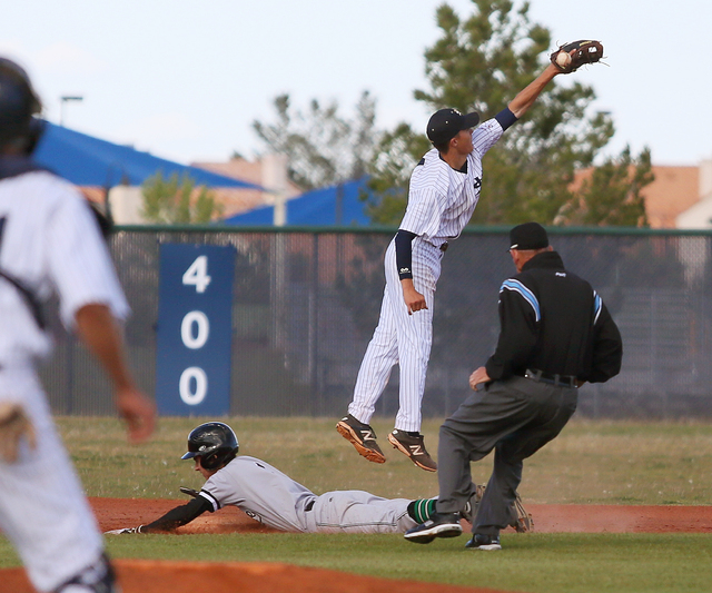 Palo Verde's Michael Spada, left, slides into second base under Spring Valley's Bryce Bullock during a baseball game at Spring Valley on Tuesday. Palo Verde won, 6-5. (Ronda Churchill/Las Vegas Re ...