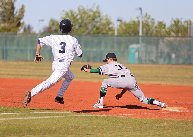 Spring Valley's Zane Drachler, left, runs to first base as Palo Verde's Sam Powers forces him out on Tuesday. Palo Verde won 6-5. (Ronda Churchill/Las Vegas Review-Journal)