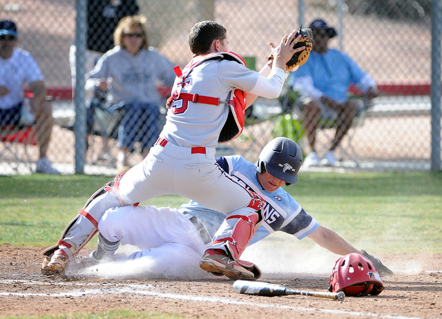 Foothill's Ryan Moyes is tagged out by Liberty catcher Nick Rush as he slides into home plate during the fourth inning on Monday. Foothill won, 11-9. (David Becker/Las Vegas Review-Journal)