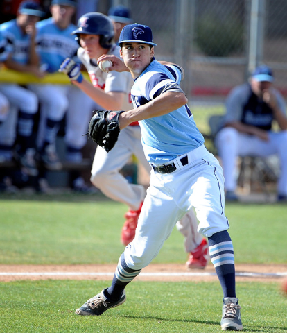 Foothill pitcher Nick Cardinale fires the ball to first to record an out on Monday. Cardinale couldn't make it out of the fifth inning, but he deliveed an RBI double during Foothill's seven-run si ...