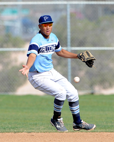 Foothill second baseman Tyler Van Stone looks to grab the ball on Monday against Liberty. Van Stone singled home the tying run during Foothill's seven-run sixth inning, and the Falcons won, 11-9.  ...