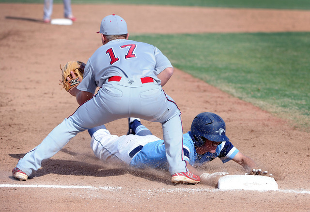 Foothill's Daniel Hauck slides safely into third base as Liberty's Josh McCollum covers the bag in a prep baseball game at Foothill on Monday. Hauck had an RBI single in a seven-run sixth inni ...
