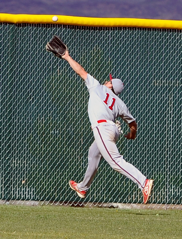 Liberty's Preston Pavlica chases down a fly ball Monday against Foothill. The Falcons rallied for seven runs in the bottom of the sixth to earn an 11-9 win over the Patriots. (David Becker/Las Veg ...