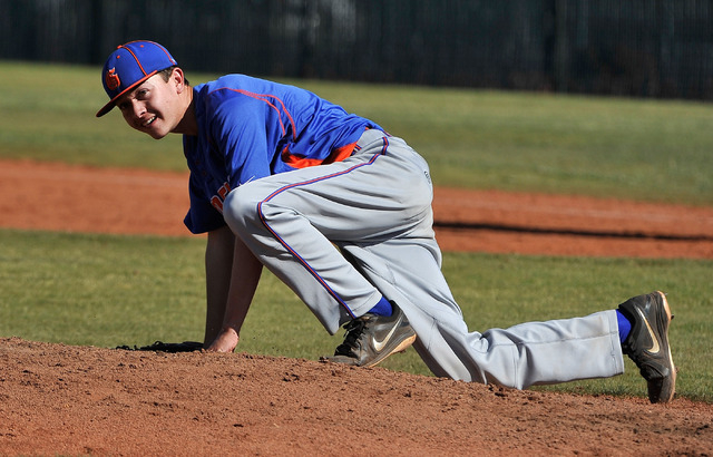 Bishop Gorman freshman left-hander Matt Mitchell manages a smile after being hit in the right shin by a line drive off the bat of Cimarron-Memorial leadoff hitter Logan Bottrell in the bottom of t ...