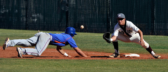 Bishop Gorman's Cole Krzmarzick dives back to first base during an attempted pickoff with Cimarron-Memorial's Tyler Giovinco on Monday. Krzmarzick and the Gaels earned a 4-1 Southwest League win.  ...